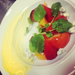 Heirloom tomato and Strawberry salad with blue cheese and a roasted corn puree